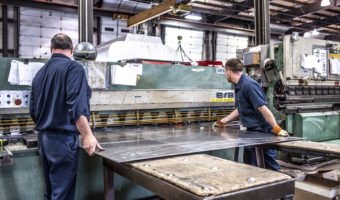 This process starts by taking a flat sheet of metal, then it is rolled to create the side shell tank shape.